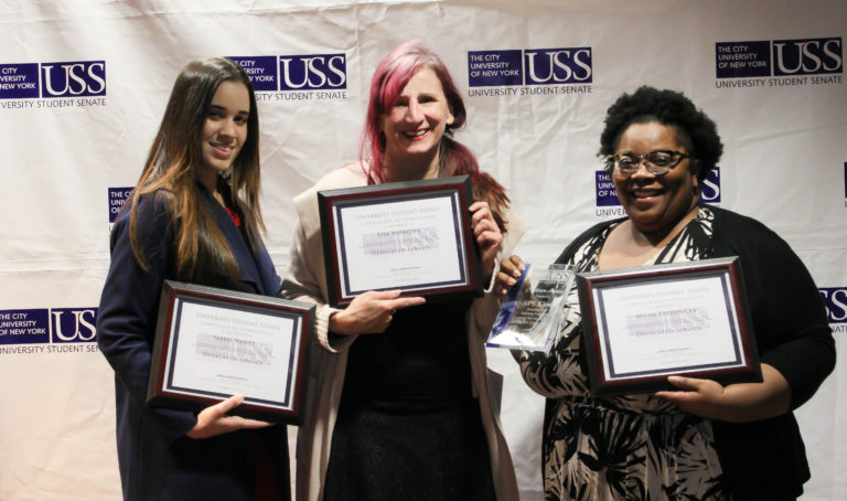 Kiosk members: Yerelyn Nunez, Lisa Sheridan, and Milan Fredricks with awards