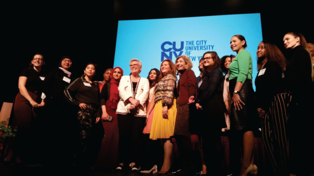 Keynote speaker Halla Tómasdóttir (in white jacket) with CUNY leaders and students